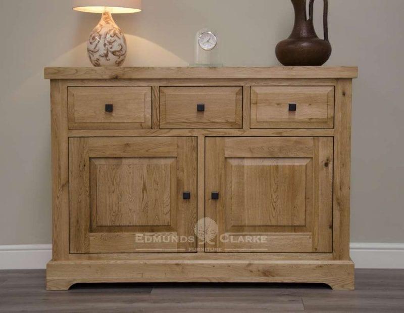 Melford solid oak medium sideboard. Deluxe Rustic Melford solid oak medium sideboard with three drawers two doors oak shelves inside cupboards DLXLMSB