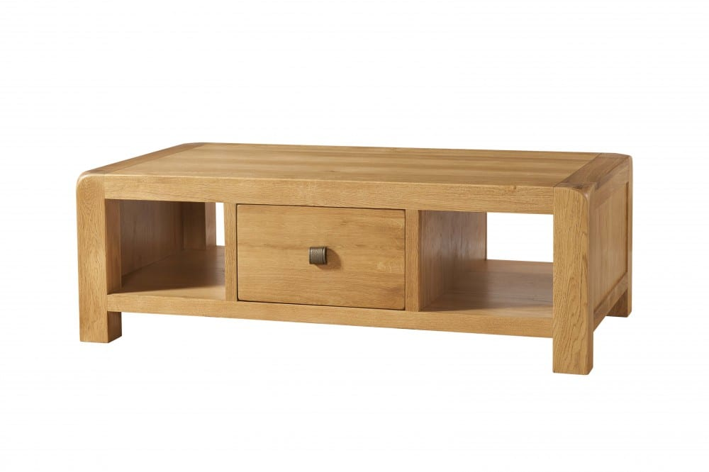 Avon oak large coffee table with drawer. Contemporary and Quirky Waxed Oak with smooth edges. coffee table with square shelf space either side of drawer fitted with square rustic knobs that pulls out from both sides. DAV12
