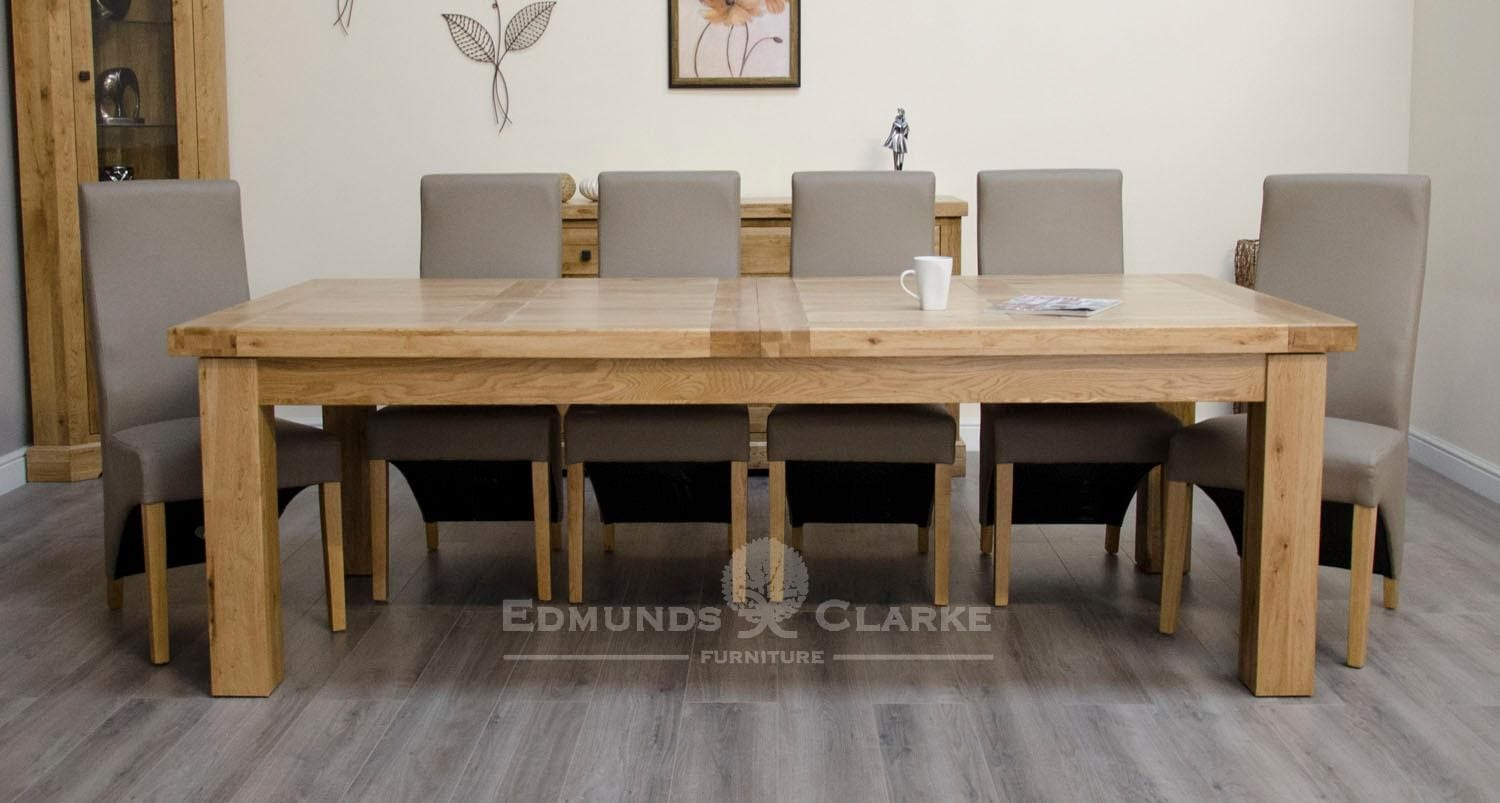Melford Solid Oak 240cm Extending Dining Table. chunky, two leaves that store underneath will sit 8 to 12 people comfortably DLX2400EXT