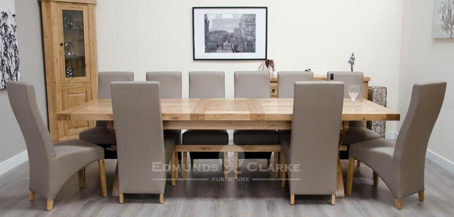 Melford Solid Oak 2400 Extending Dining Table chunky, showing 1 leaf that store underneath will sit 8 to 12 people comfortably DLX2400EXT