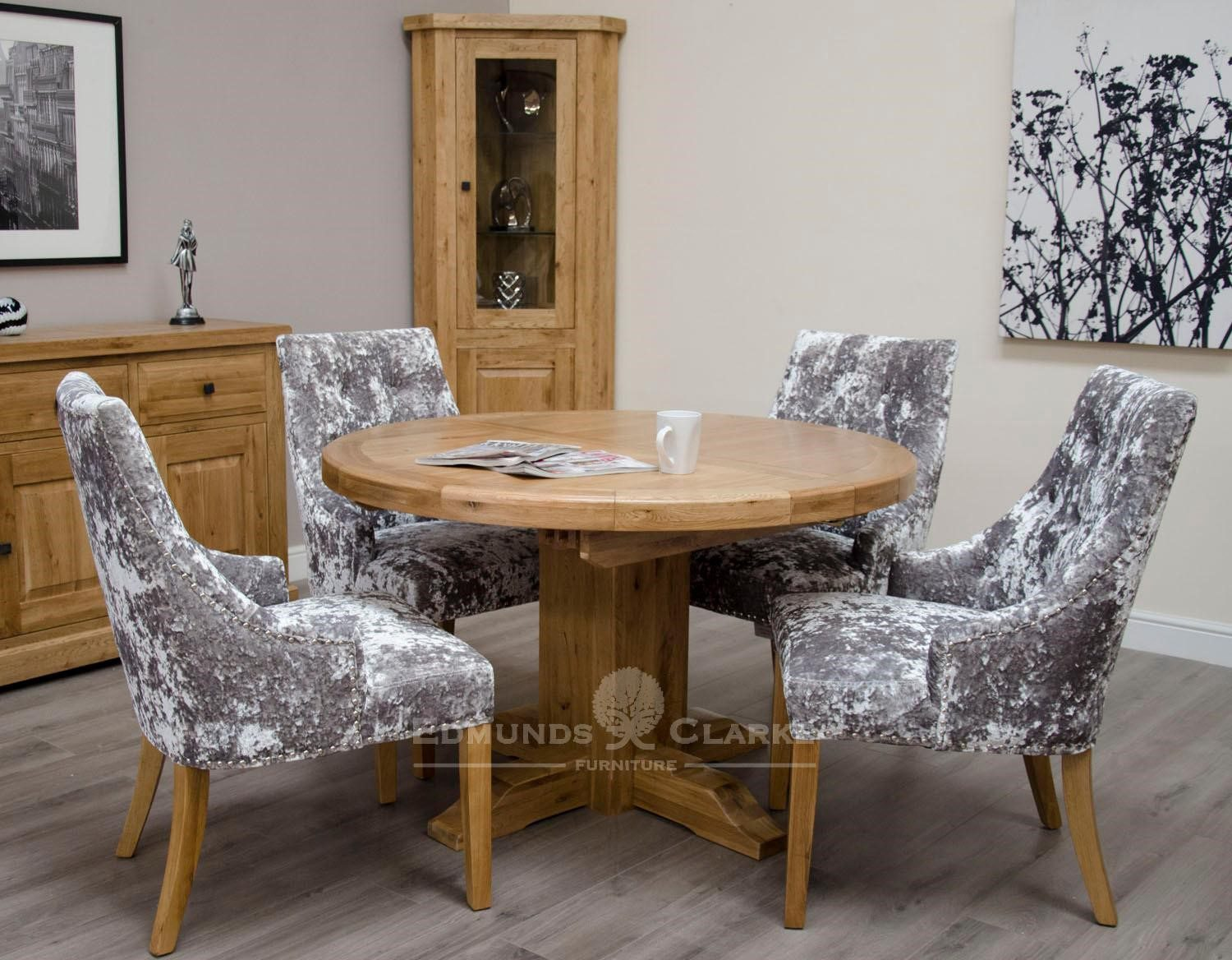 Melford solid oak round extending table showing closed but includes 165cm one leaf that stores underneath will sit 4 to 6 people comfortably DLXRNDEXT