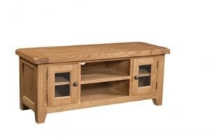 Somerset Oak Large TV Unit. Small glass doors to the left and right with shelf in both sides. Centre shelf. Chunky contemporary waxed oak .chunky top, tapered legs and dark antique brass round rustic round knobs. SOM072