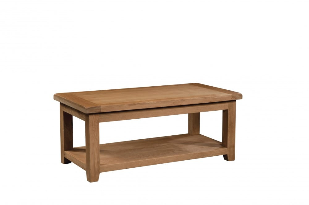 Somerset Oak Large Coffee Table. Chunky contemporary waxed oak .chunky top, tapered legs with handy shelf under. SOM075