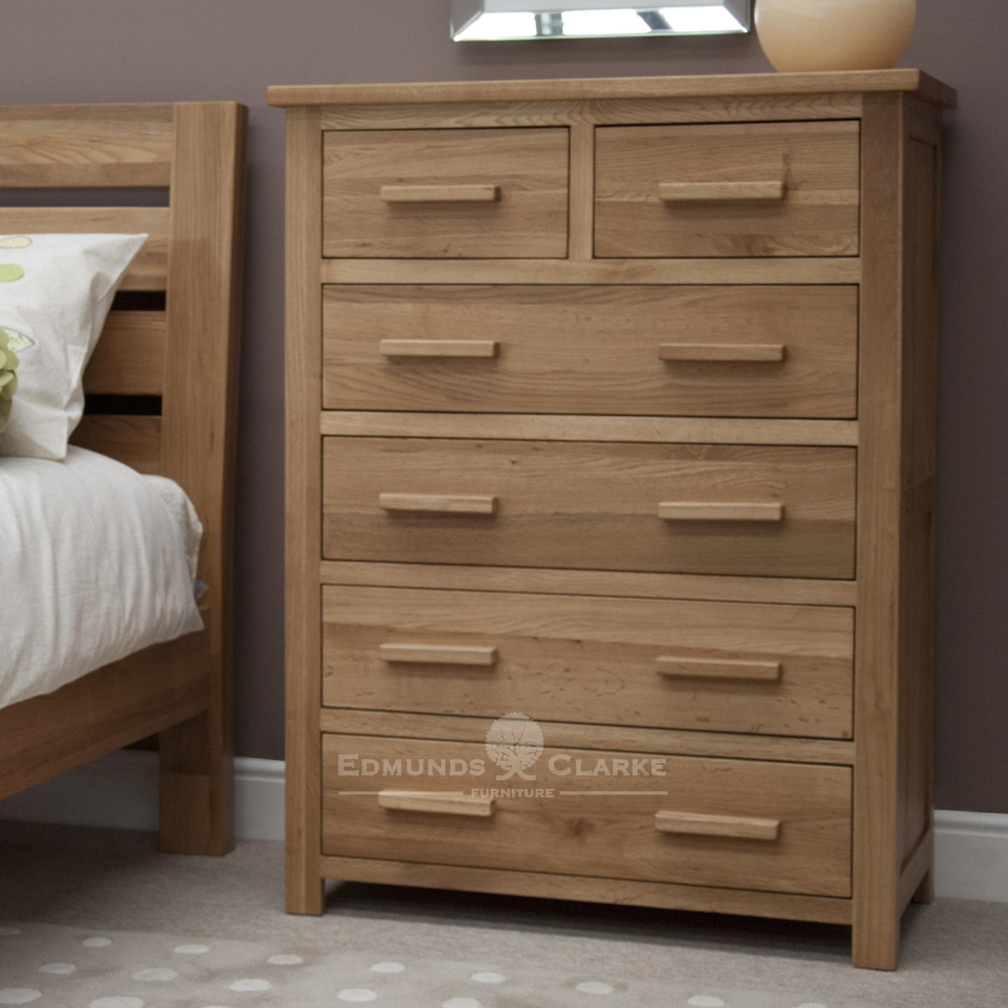 Bury Solid Oak 6 drawer chest. two drawers at the top and 4 long drawer underneath. light lacquered oak finish with choice of metal or wood bar handles