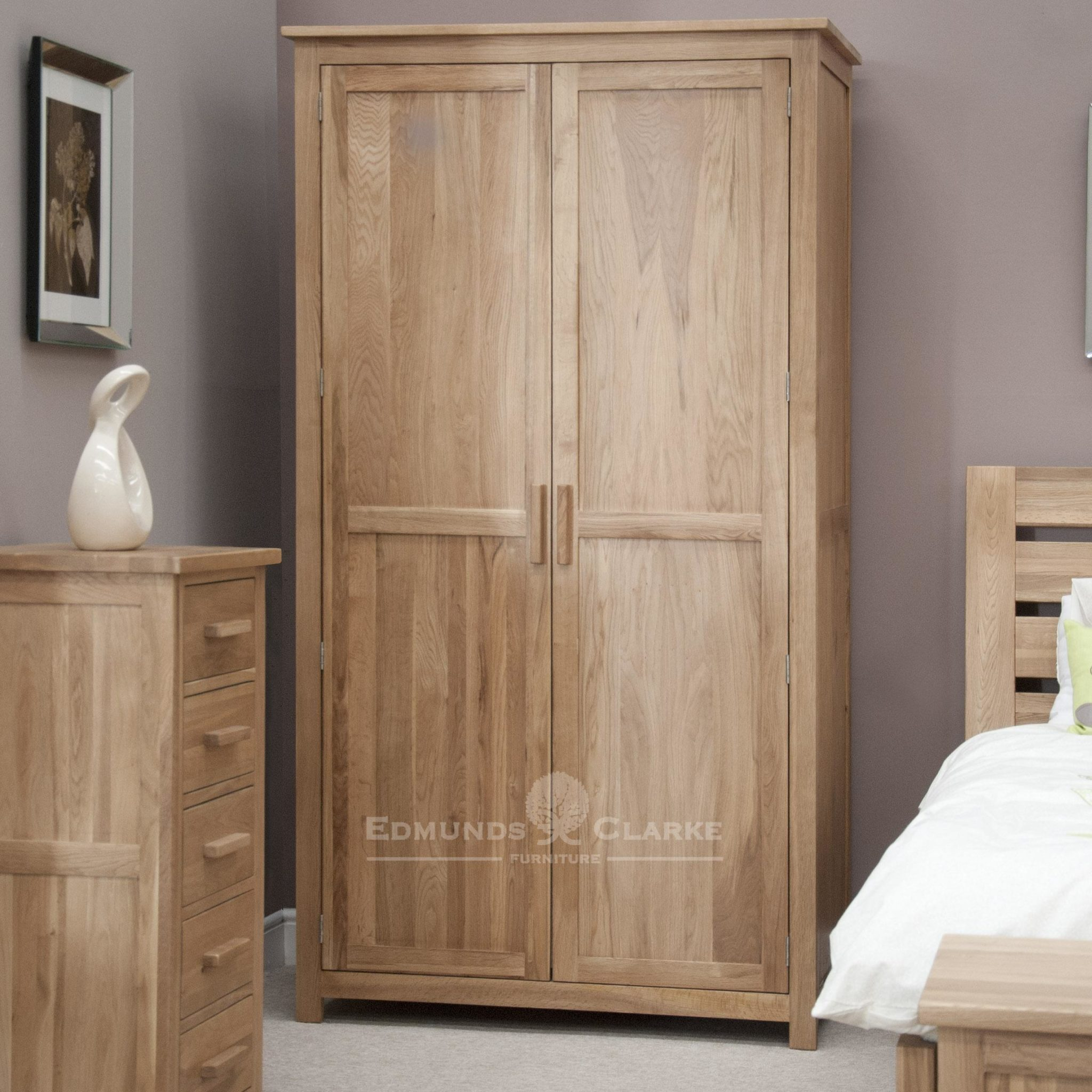 Bury Solid oak double wardrobe. all hanging finished in light lacquer oak with choice of handles