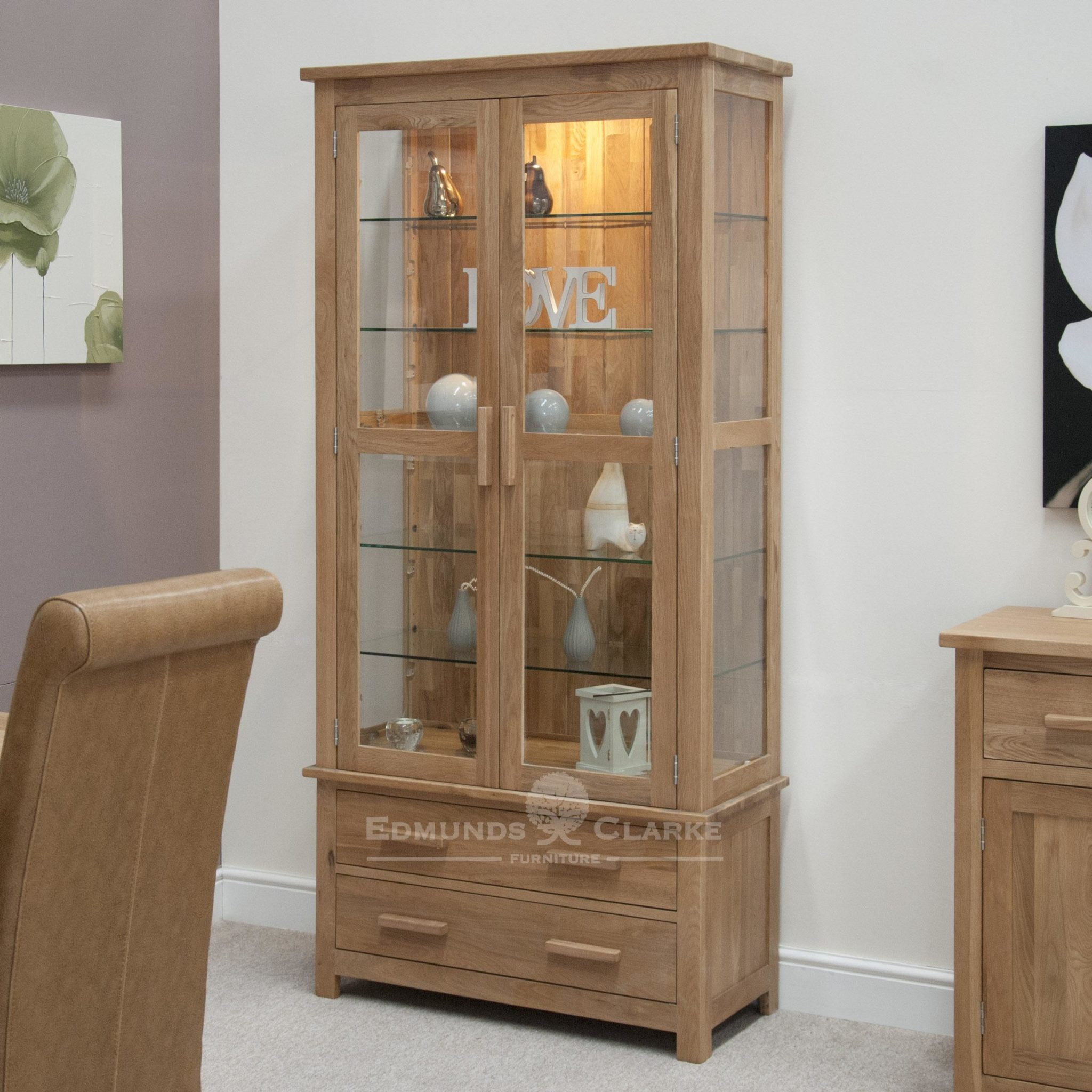 Bury Solid Oak Glass Display Cabinet, bevelled glass at front and sides with LED light to show your treasures off. two handy drawers at bottom, chrome or oak bar handles available