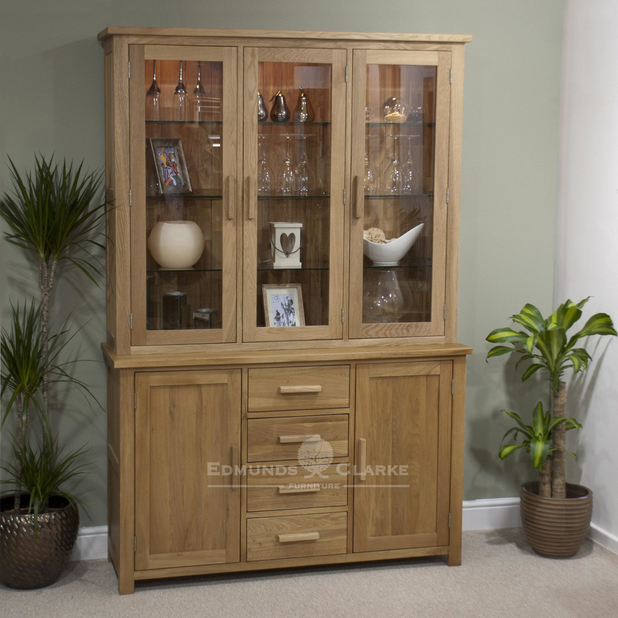 Bury Large Oak Dresser. chrome handles as stndard, oak bar handles available as optional extra. 4 centre drawers & cupboards with glass bevelled doors above and adjustable glass shelves