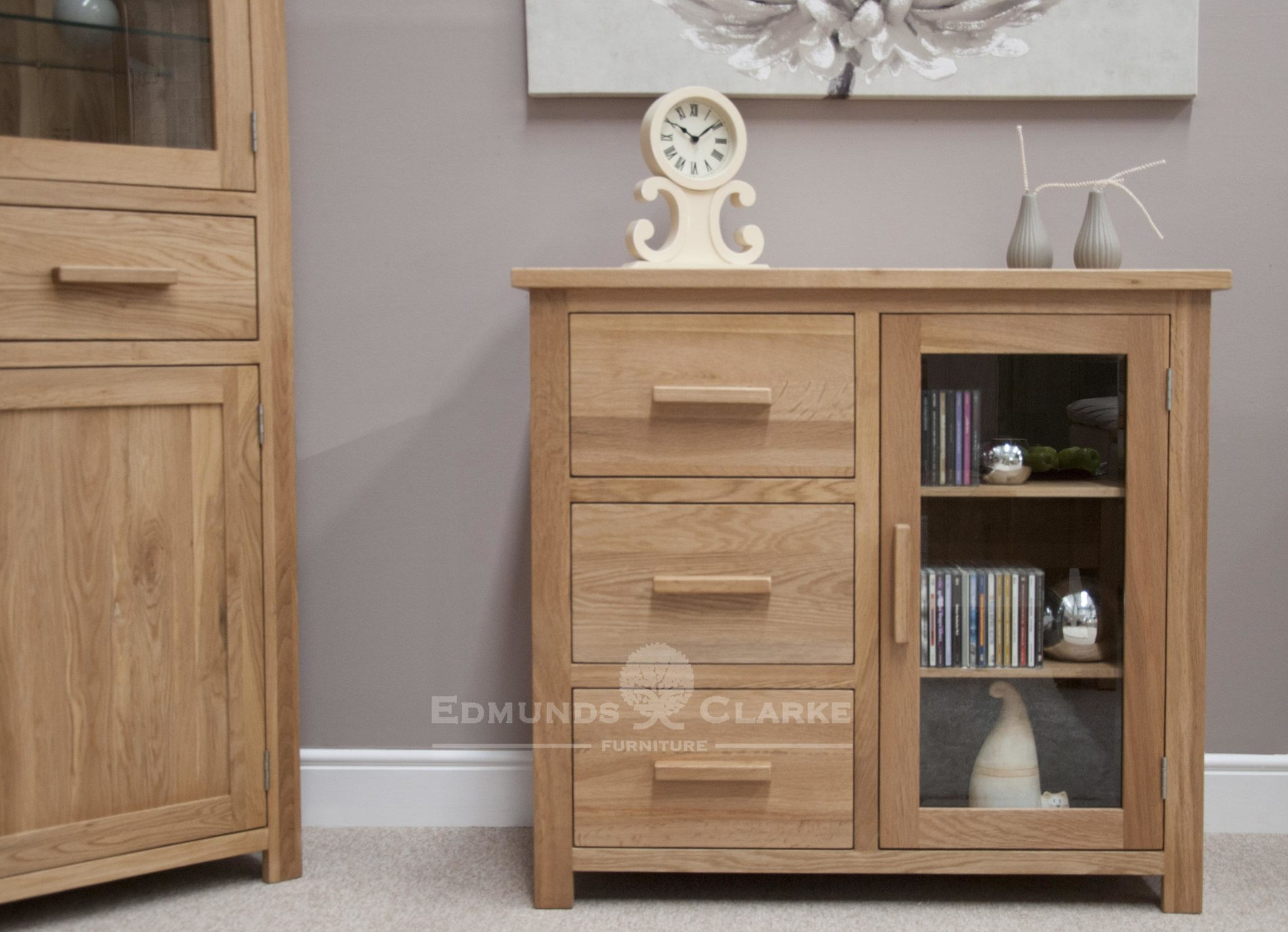 Bury small oak glazed chest, 3 drawers to the left and small glazed door to right with adjustable oak shelves, chrome fitted handle fitted as standard
