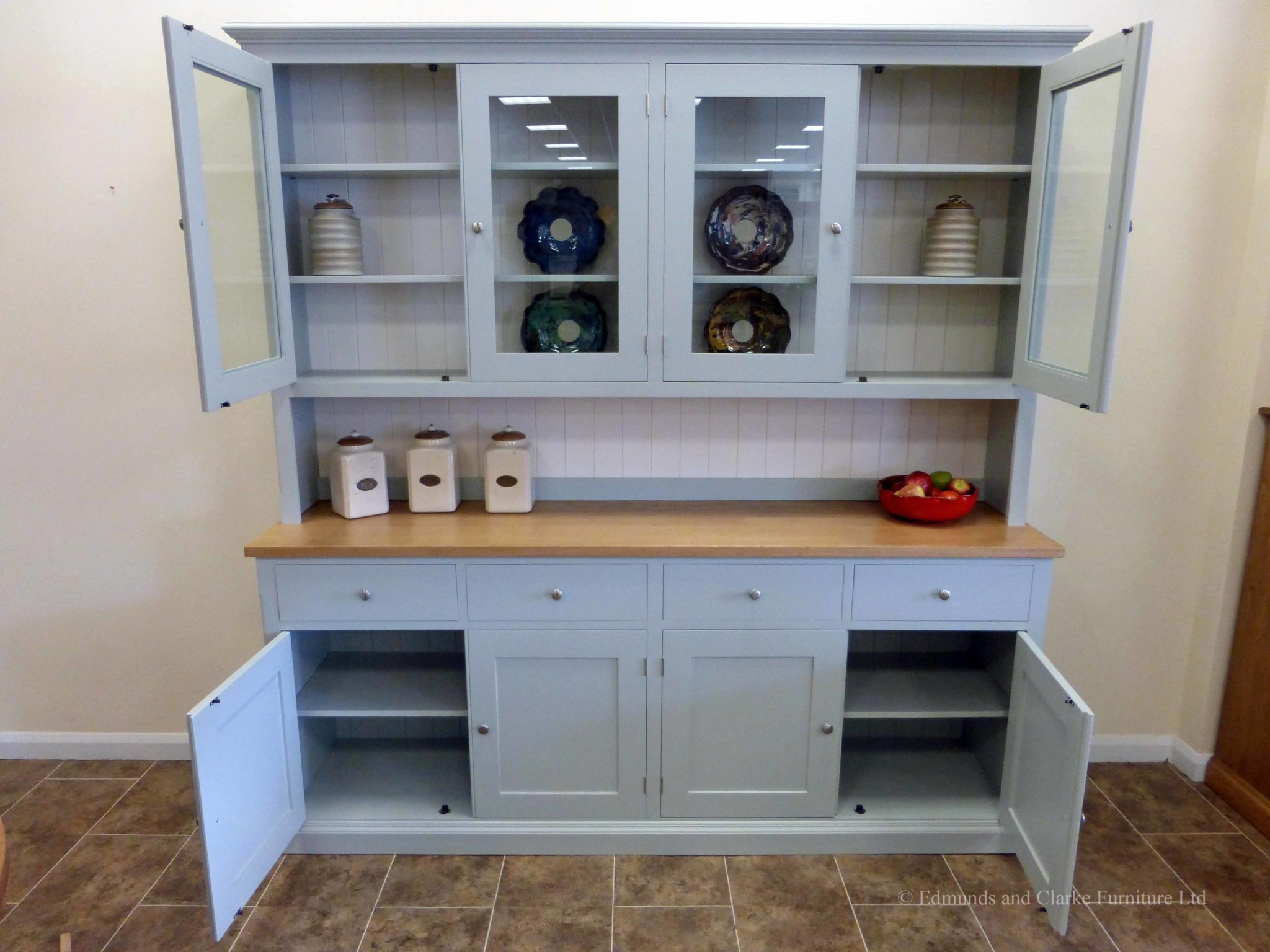 7ft Painted Half glazed dresser. Handmade with solid oak top on the sideboards, painted shelves, 4 drawers with 4 large cupboards below. 4 door glazed rack above painted in southwold sky blue and satin nickel knobs. contrasting white backboards on racking EDM021