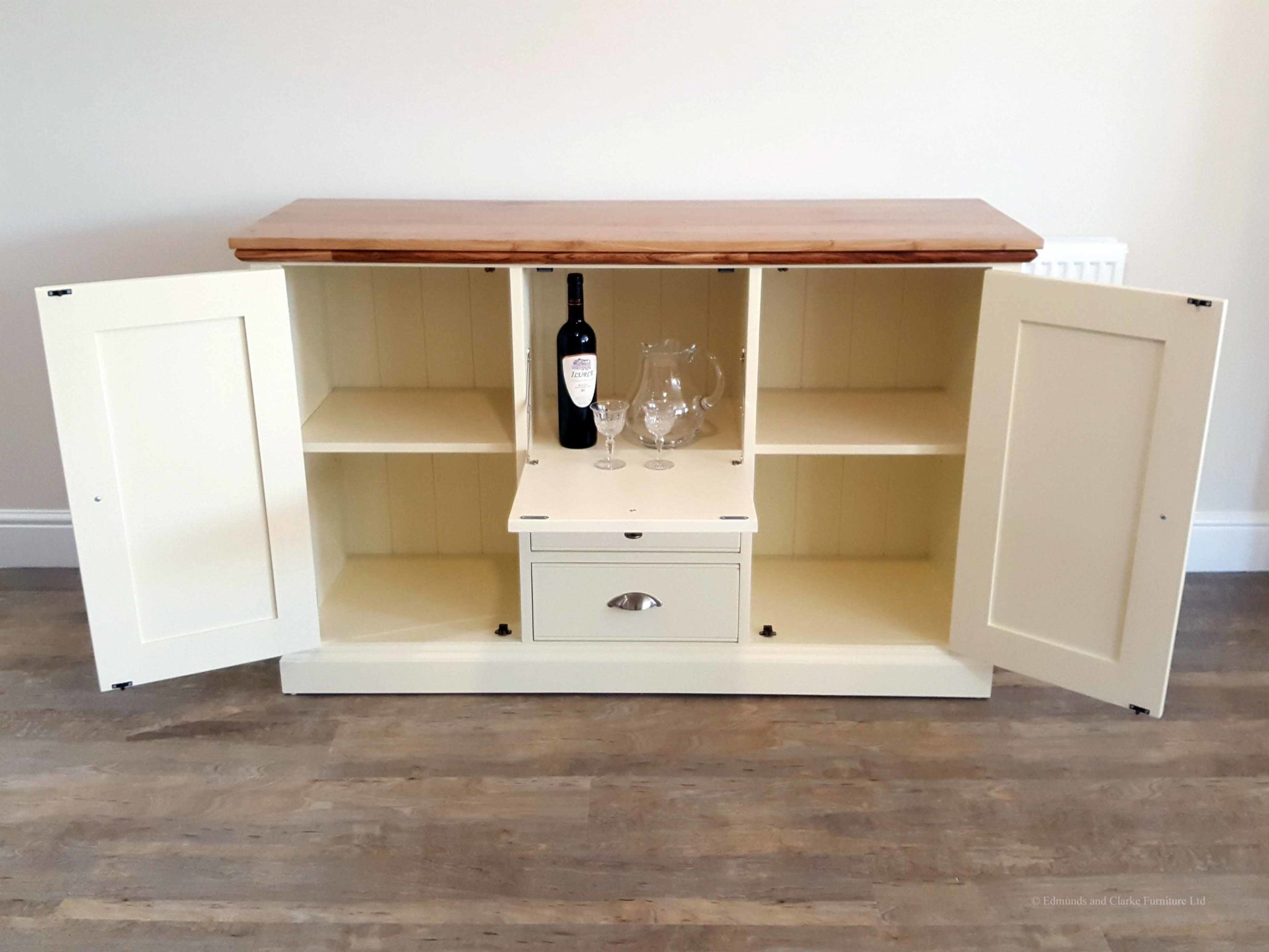 Edmunds painted drinks cabinet sideboard. Moulded oak top, centre drop down door and drawers under and 2 doors either side. choice of handles. EDM039
