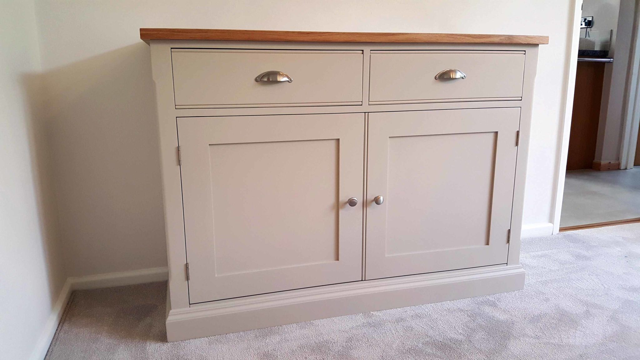 Edmunds Painted 4ft Sideboard. 25mm oak top. 2 drawers and 2 doors with adjustable shelves within. image showing dunwich stone with chrome cup handles and knobs. choice of handles. EDM040