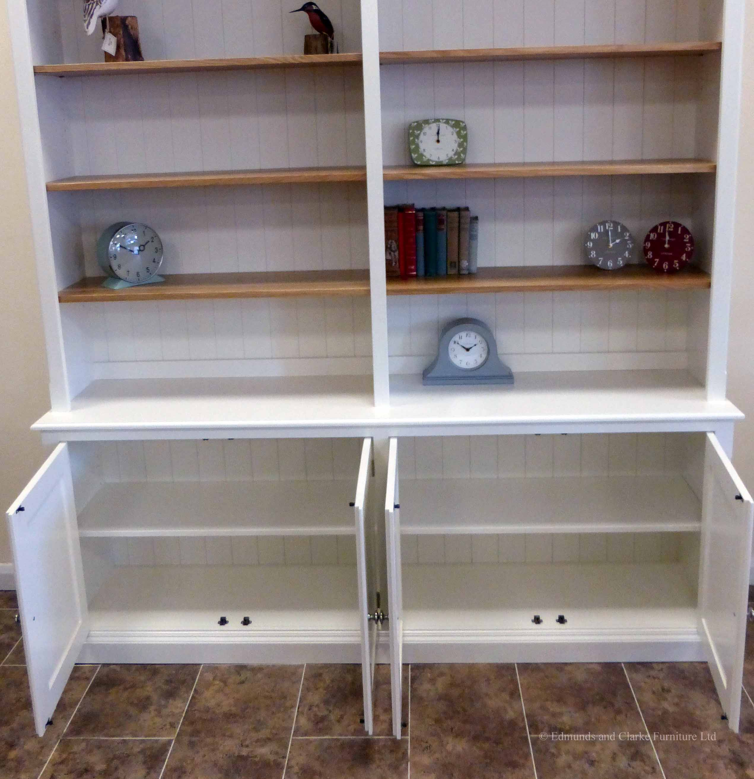 Edmunds 2 metre Painted double library bookcase, painted all over with adjustable oak shelves, cupboard under with 4 doors. adjustable shelves, choice of handles and knobs. image showing doors open. EDM048