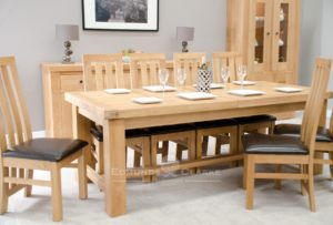 Hadleigh Solid Oak Extra Large Extending Dining Table. Light oak finish, 2 extending leaves, can seat up to 14 people