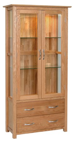 Norwich Oak Glass Display Cabinet.contemporary shaker style straight lines and shaped edges on tops. shaped chrome bar handles.Glass shelves are adjustable. 2 handy drawers at the bottom NNG40