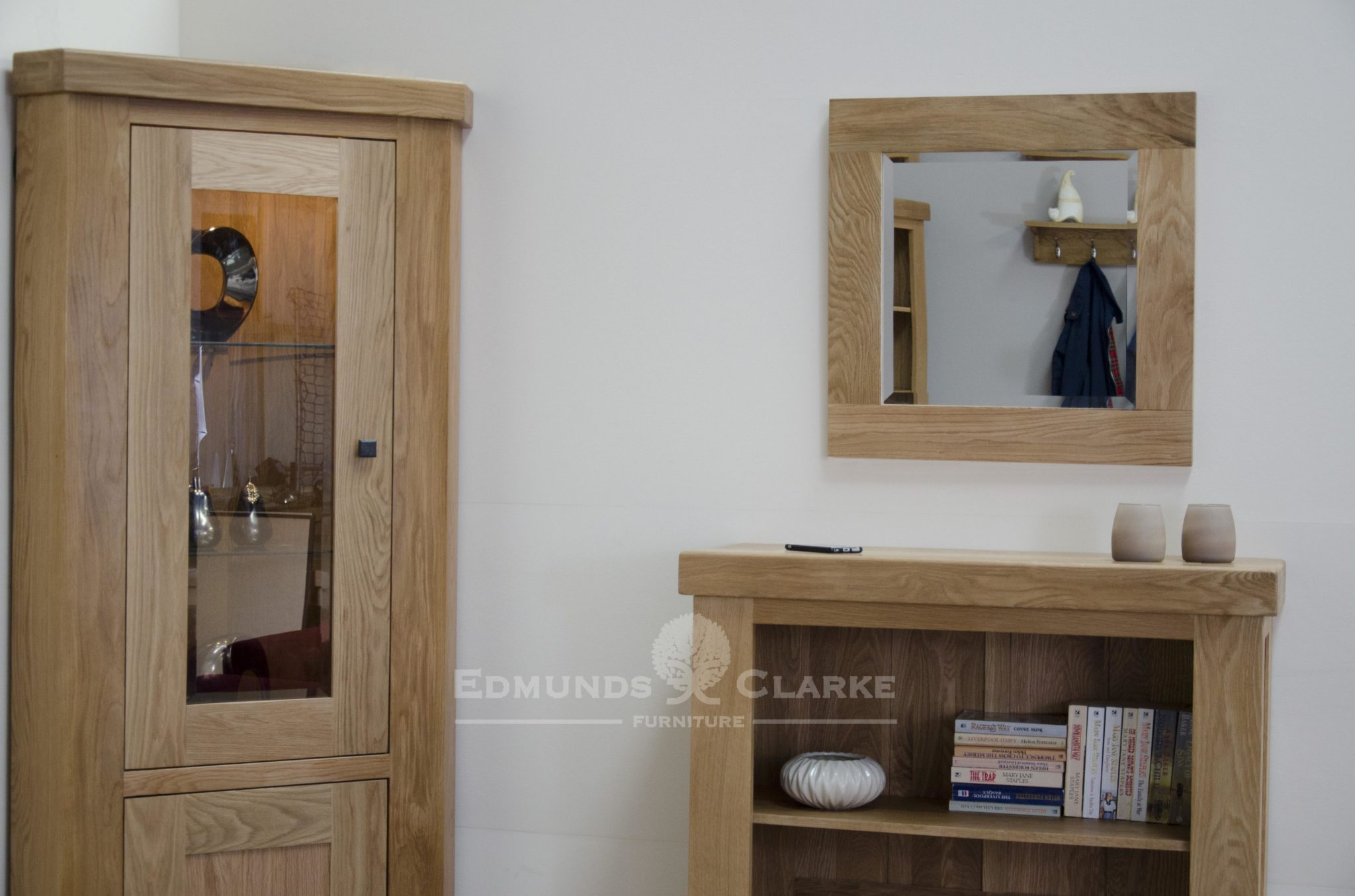 solid oak square wall mirror 60cm  x 60cm. Bevelled glass in a light oak frame