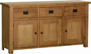 Sudbury Oak Large Sideboard. rustic shaker style with rounded edges. 3 hadny drawers with rustic black handles, three doors with rustic black round knobs. adjustable shelf in each door. SRS45