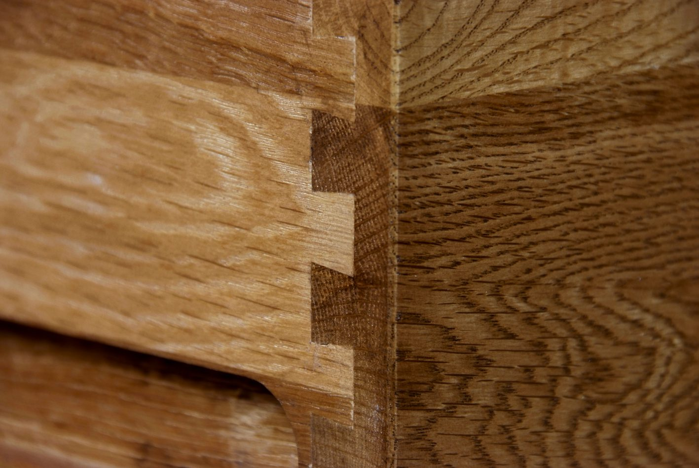 Image of Sudbury Oak drawer detail dovetail joints by Edmunds & Clarke Furniture Ltd