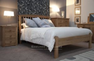 Milano Solid Oak Bed 4'6. vertical slats on headboard with slight curve capping
