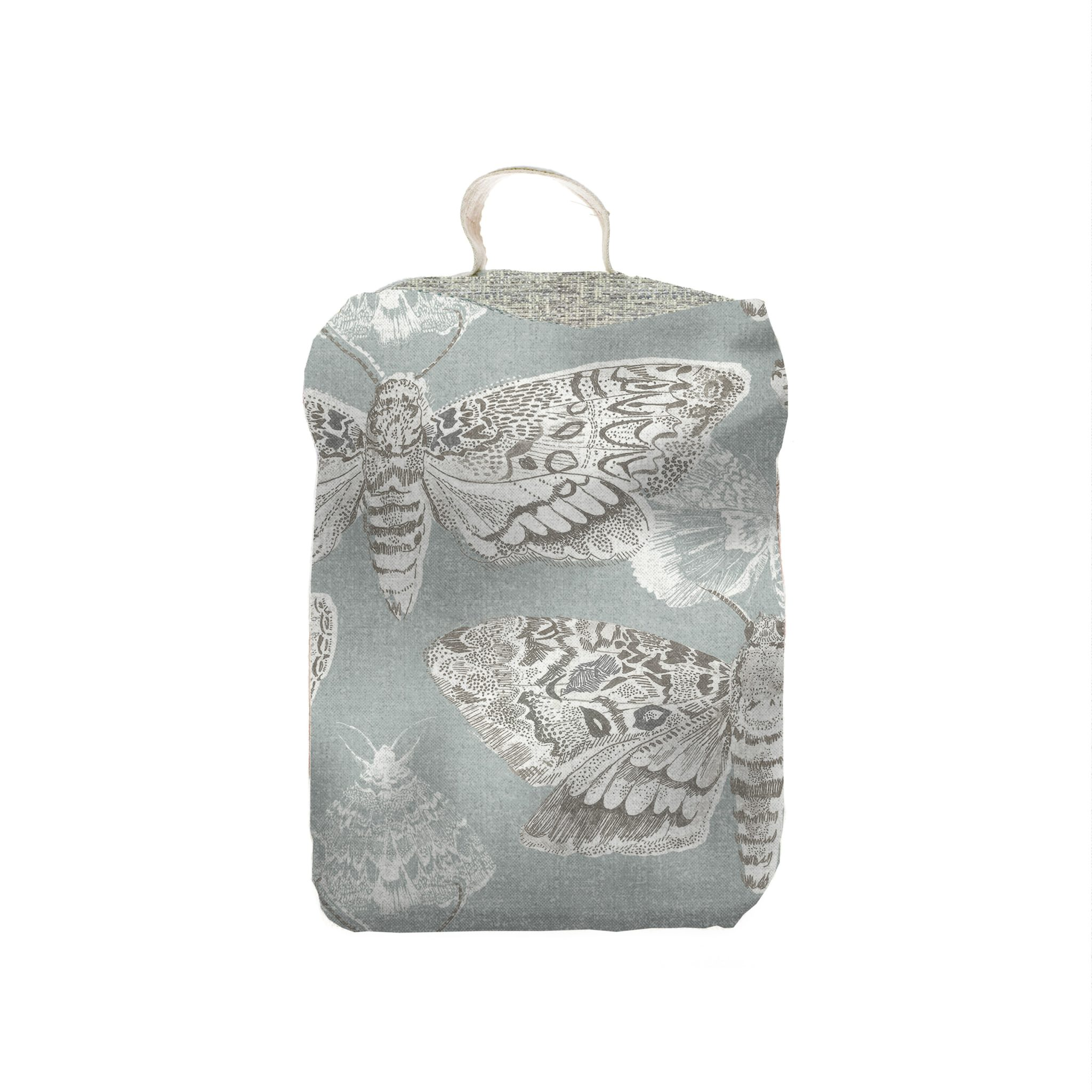 Voyage Maison Doorstop - Nocturnal. moths printed on linen background, handy handle attached. square in shape