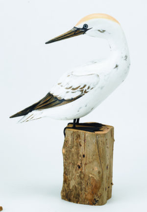 Archipelago Gannet Preening Wood Carving D316, perched on a wood block, hand painted and carved. Fairtrade