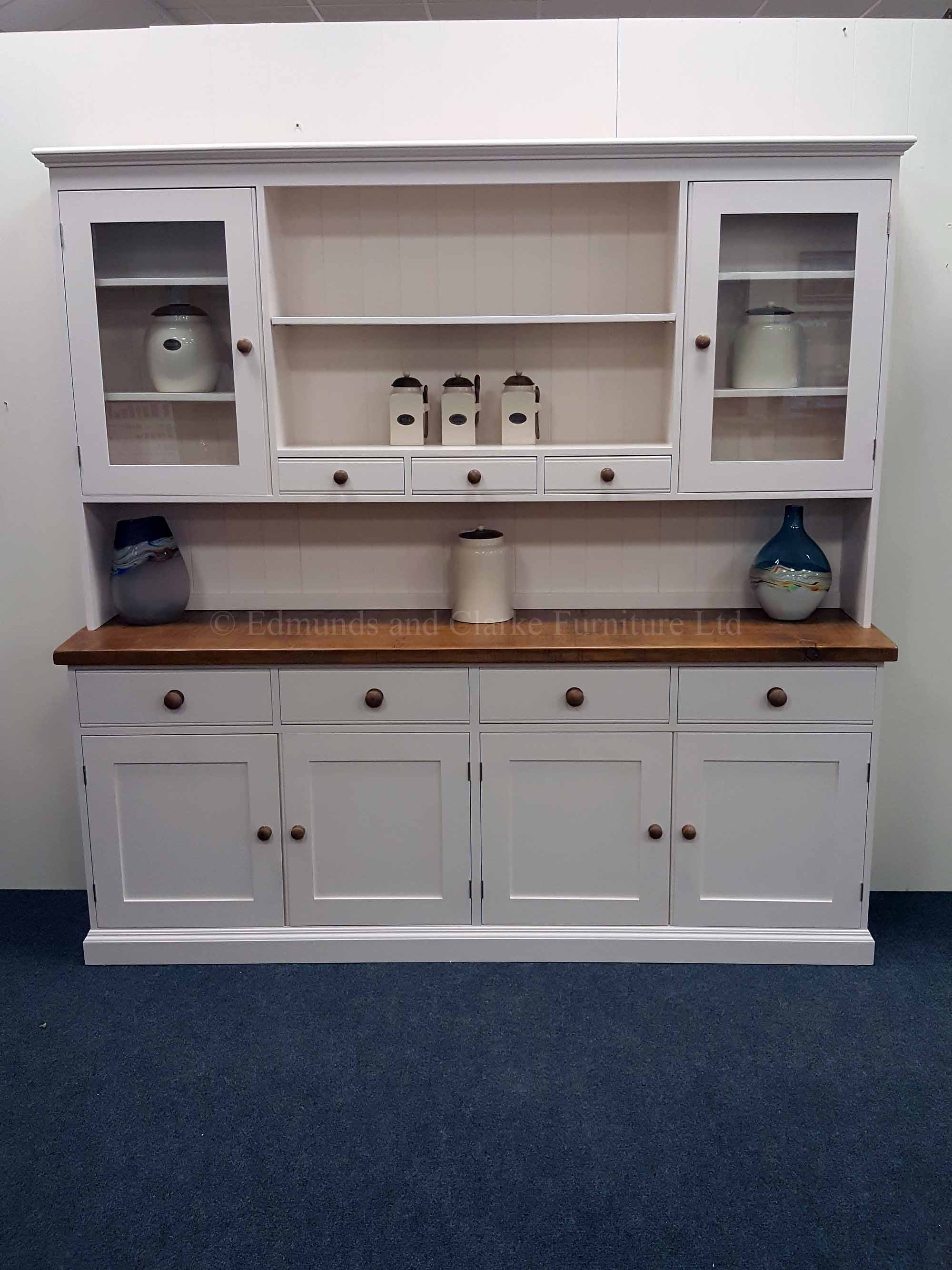 Plain Painted 7ft Kitchen Dresser. image showing rough sawn chunky pine top with matching knobs and painted shelves on the rack. may colours and handle options available