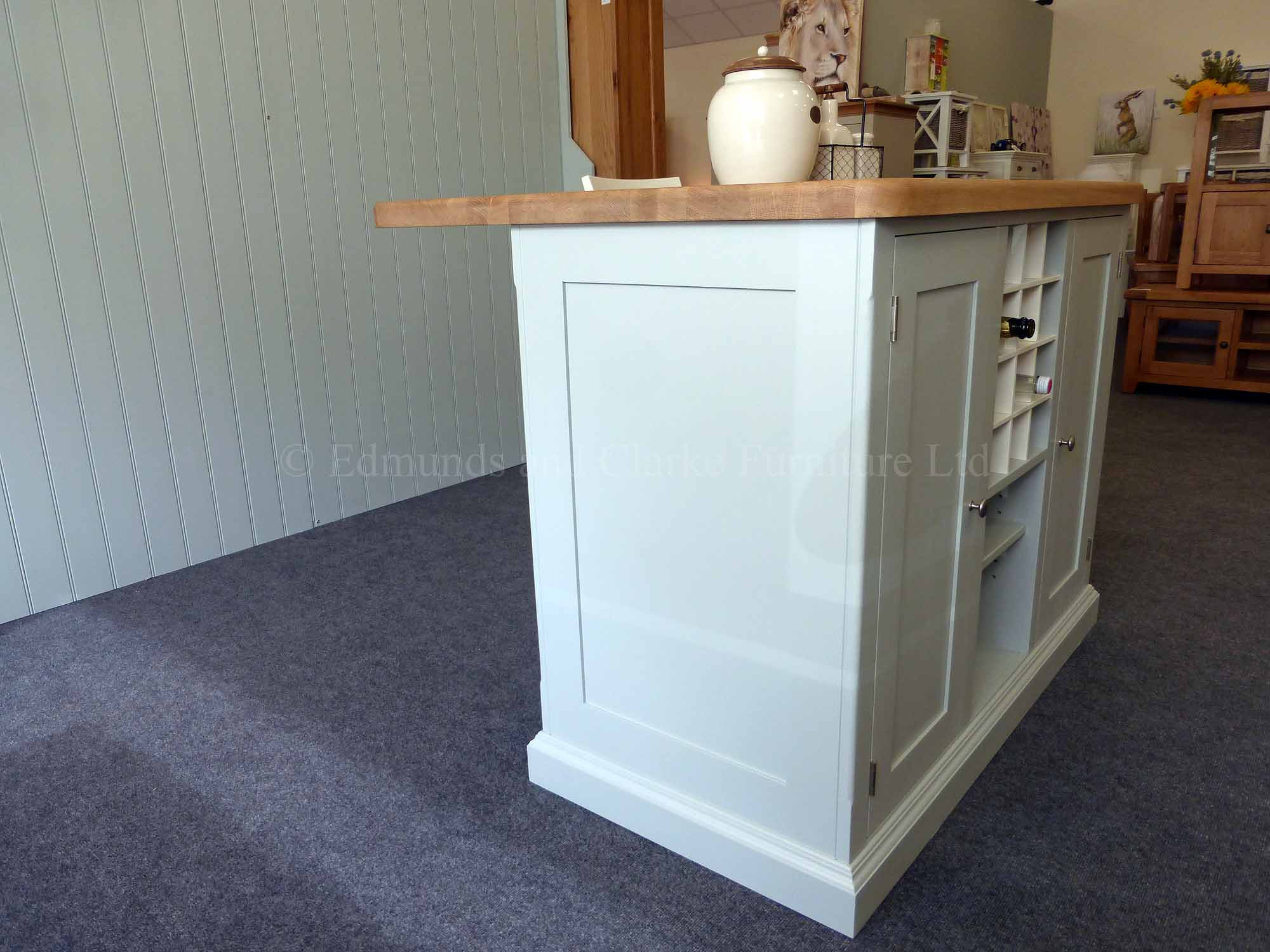 Edmunds painted 4ft x 3ft kitchen Island in Southwold Sky Blue. Solid oak top. Central shelves and wine rack with 2 paneled doors and on other side a overhang for stools. EDM008
