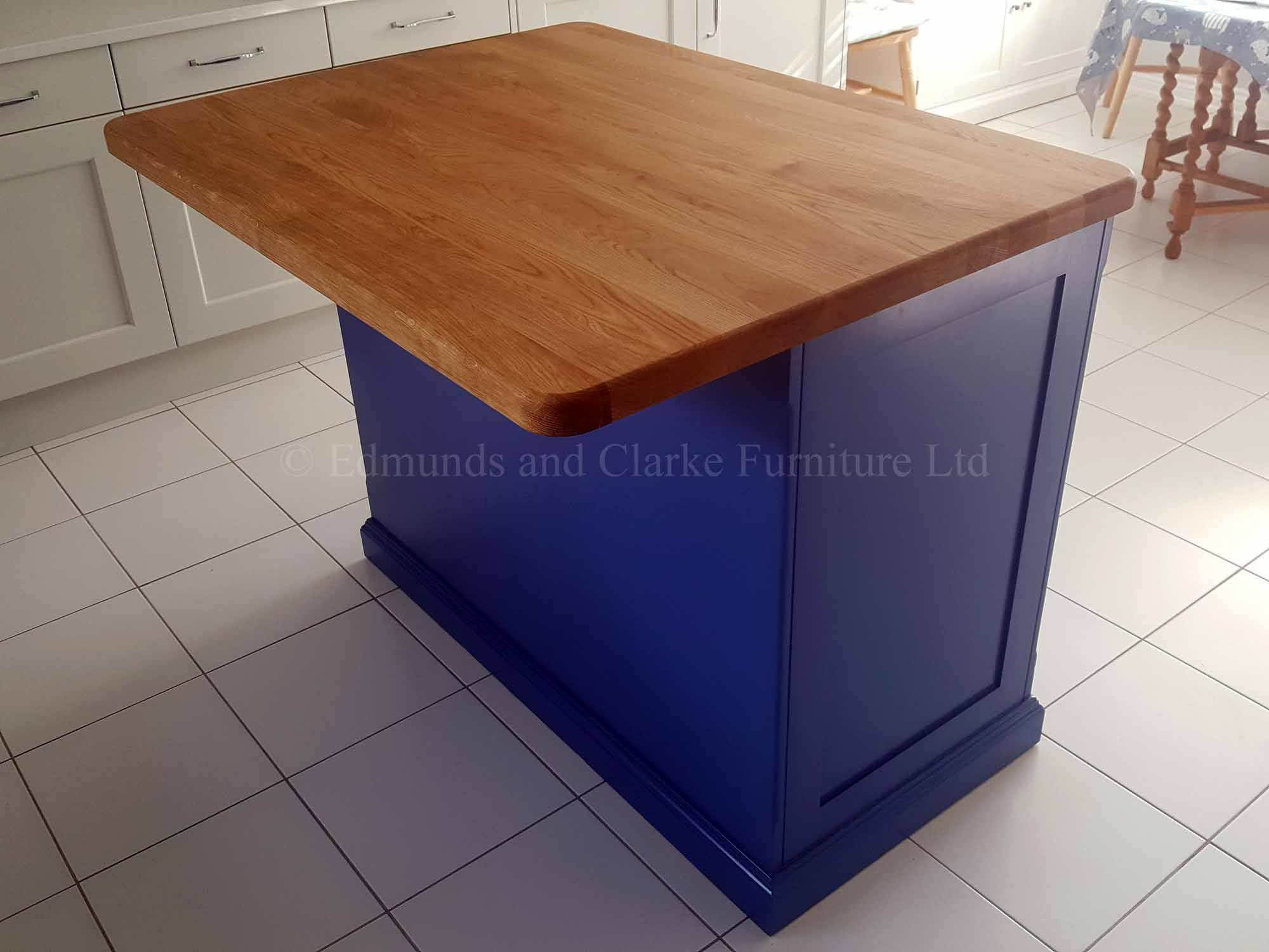 Edmunds painted 4ft x 3ft kitchen Island Colour Match. Solid oak top. Central shelves with 2 paneled doors and on other side a overhang for stools. EDM008