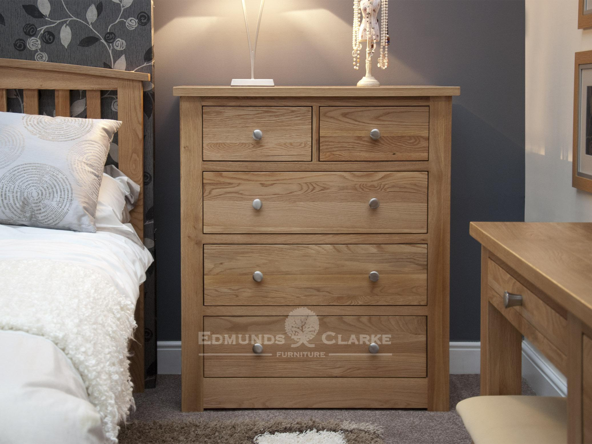 solid oak chest of drawers with two small drawers at top and three below, square edge design, chrome tapered knob