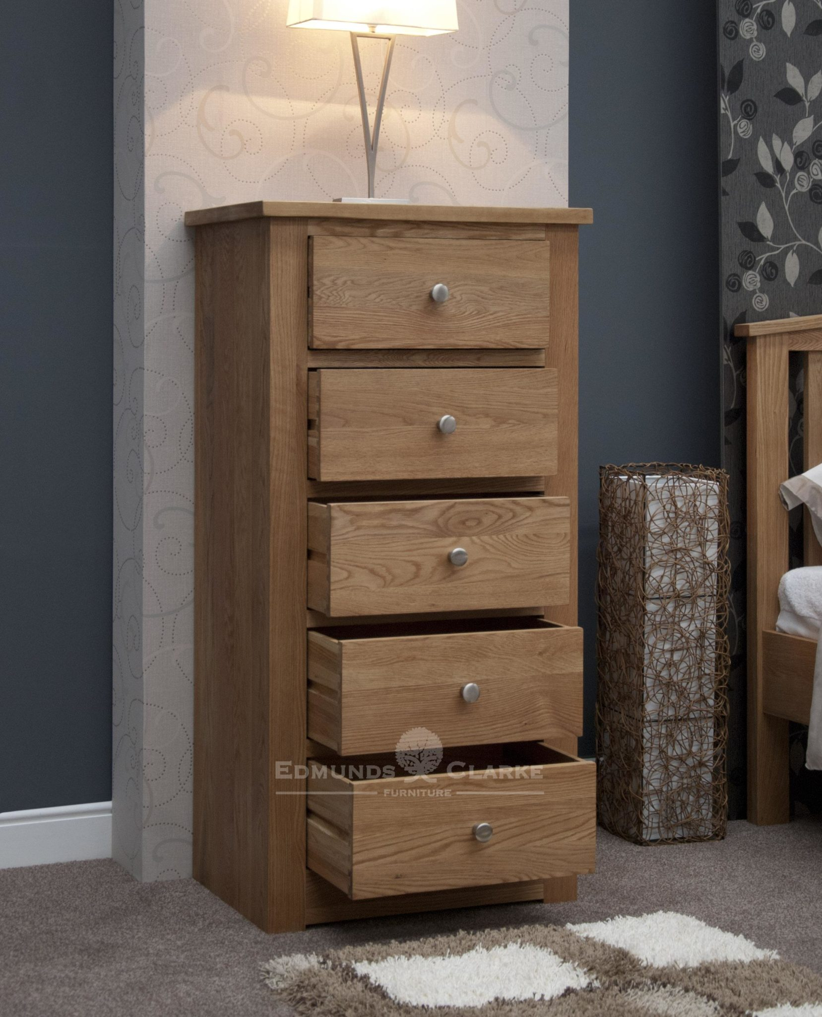 solid oak tall narrow five drawer chest, good sized drawers with chrome tapered knobs