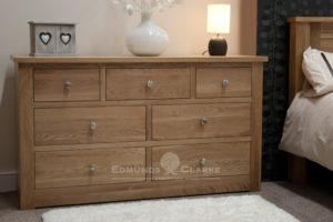 solid oak seven drawer low chest, 141cm wide by 81cm high