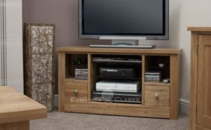 solid oak corner tv stand with drawer and open space above either side, open central gap in centre with three adjustable shelves