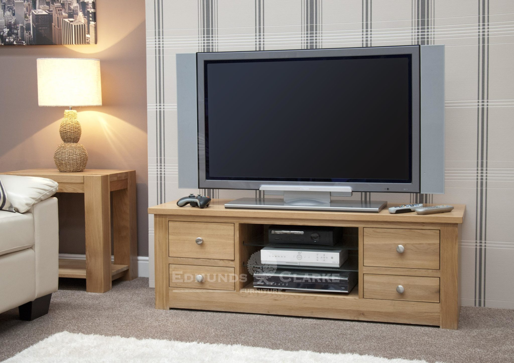 solid oak chunky square edge tv stand with two drawers down either side and open space and three shelves in centre 140cm wide