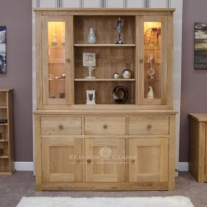 solid oak dresser three doors and drawers in sideboard, 2 full length glazed doors above with open section in centre with two shelves