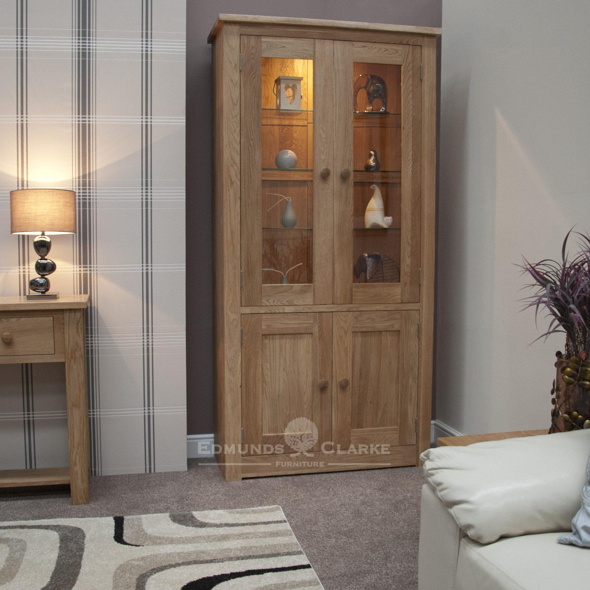 solid oak glazed 2 door cabinet with two panelled doors below