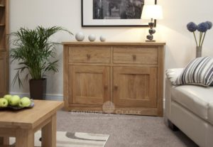 solid oak wide two door two drawer sideboard with full shelf in cupboard, chrome tapered knobs