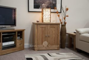 solid oak two door cupboard with one internal shelf 77 high by 75 wide by 45 centimetre deep