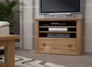 solid oak tv stand with large drawer below and open section above with two adjustable shelves