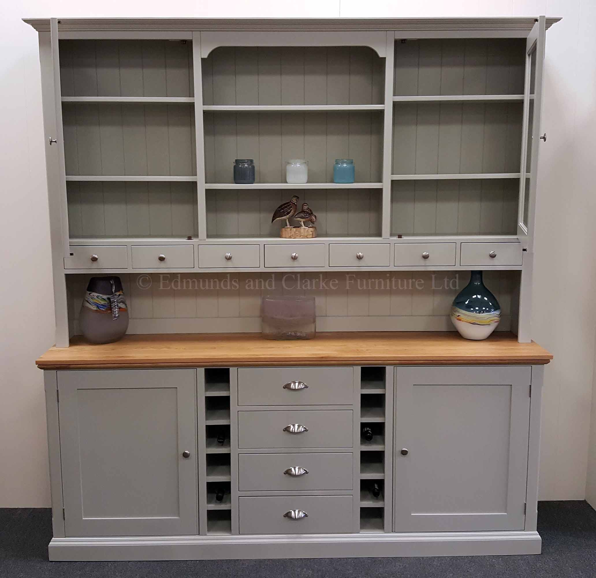 painted tall wide kitchen dresser, two large glazed doors with open central section spice drawers below, wine racks in sideboard