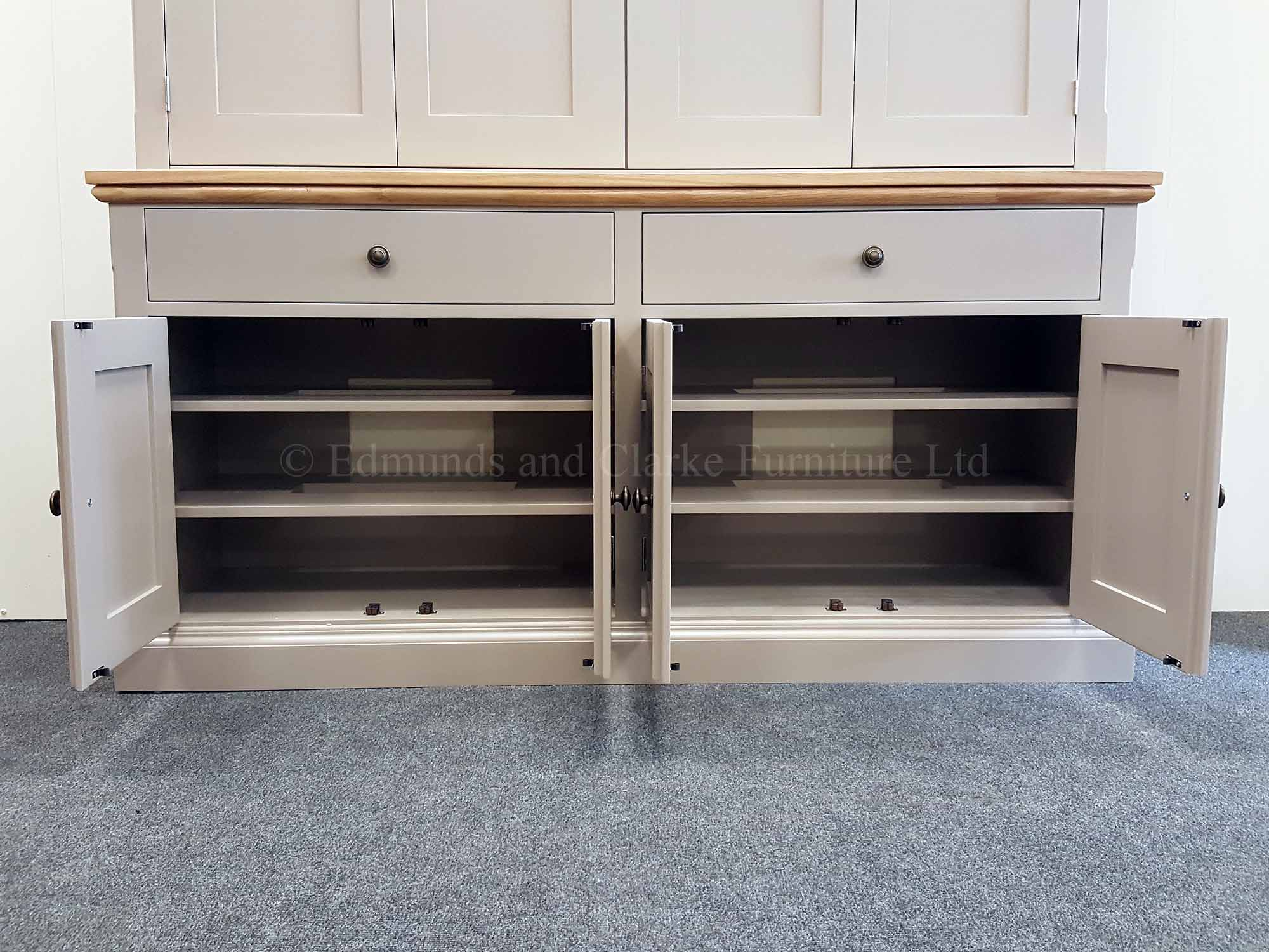 Edmunds television bifold door cupboard with adjustable shelves and drawers