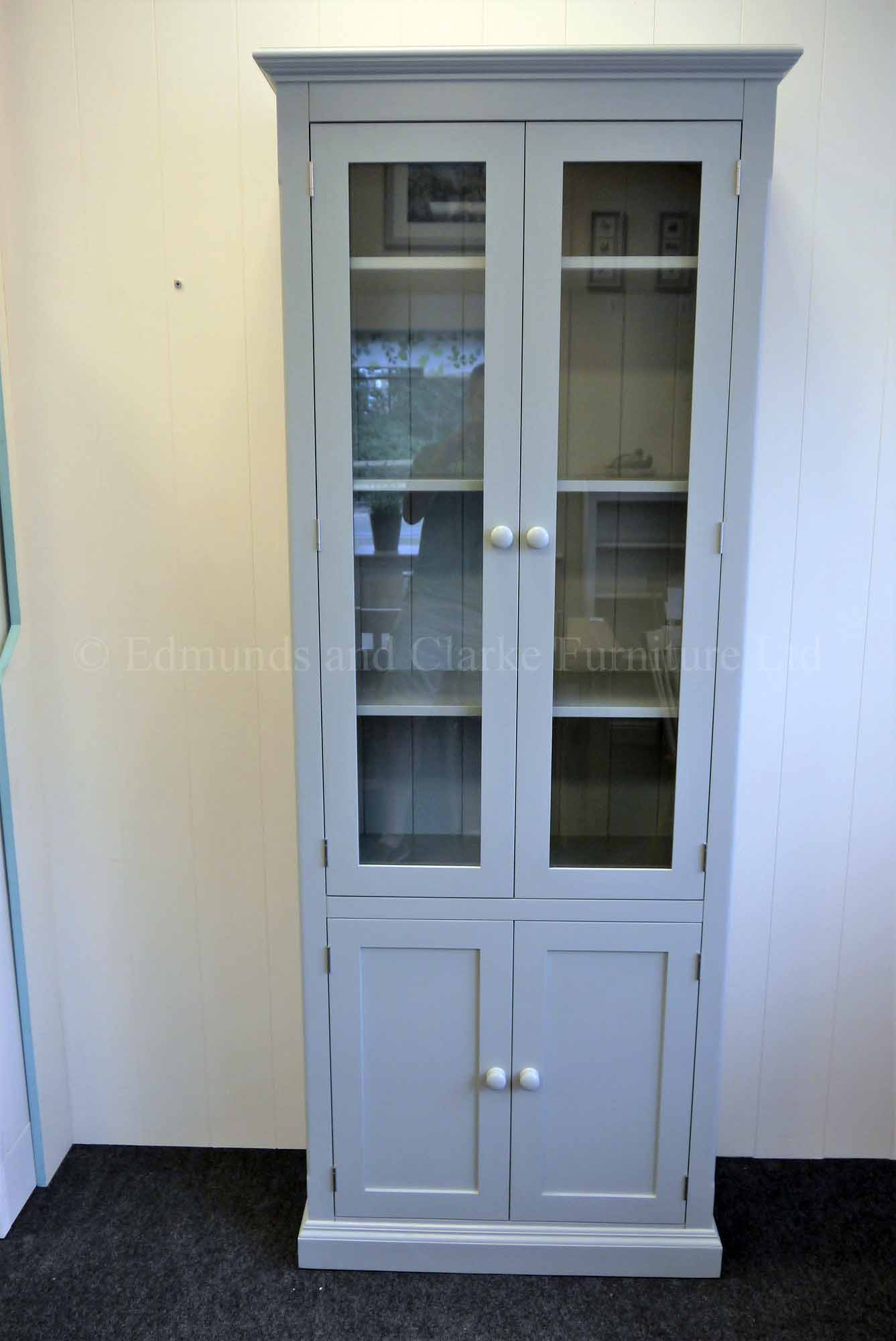 Edmunds tall narrow glazed bookcase with four doors