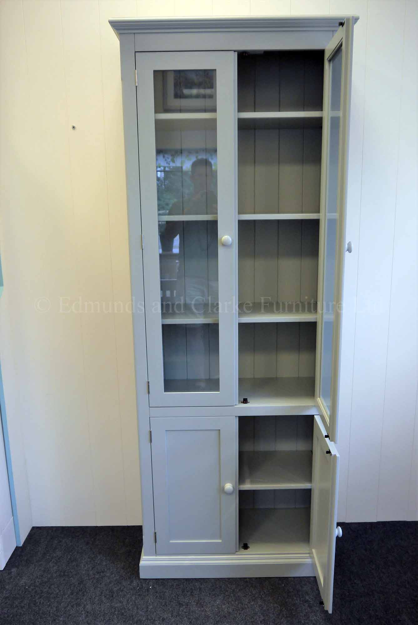 Painted glazed paneled bookcase, shelves adjustable