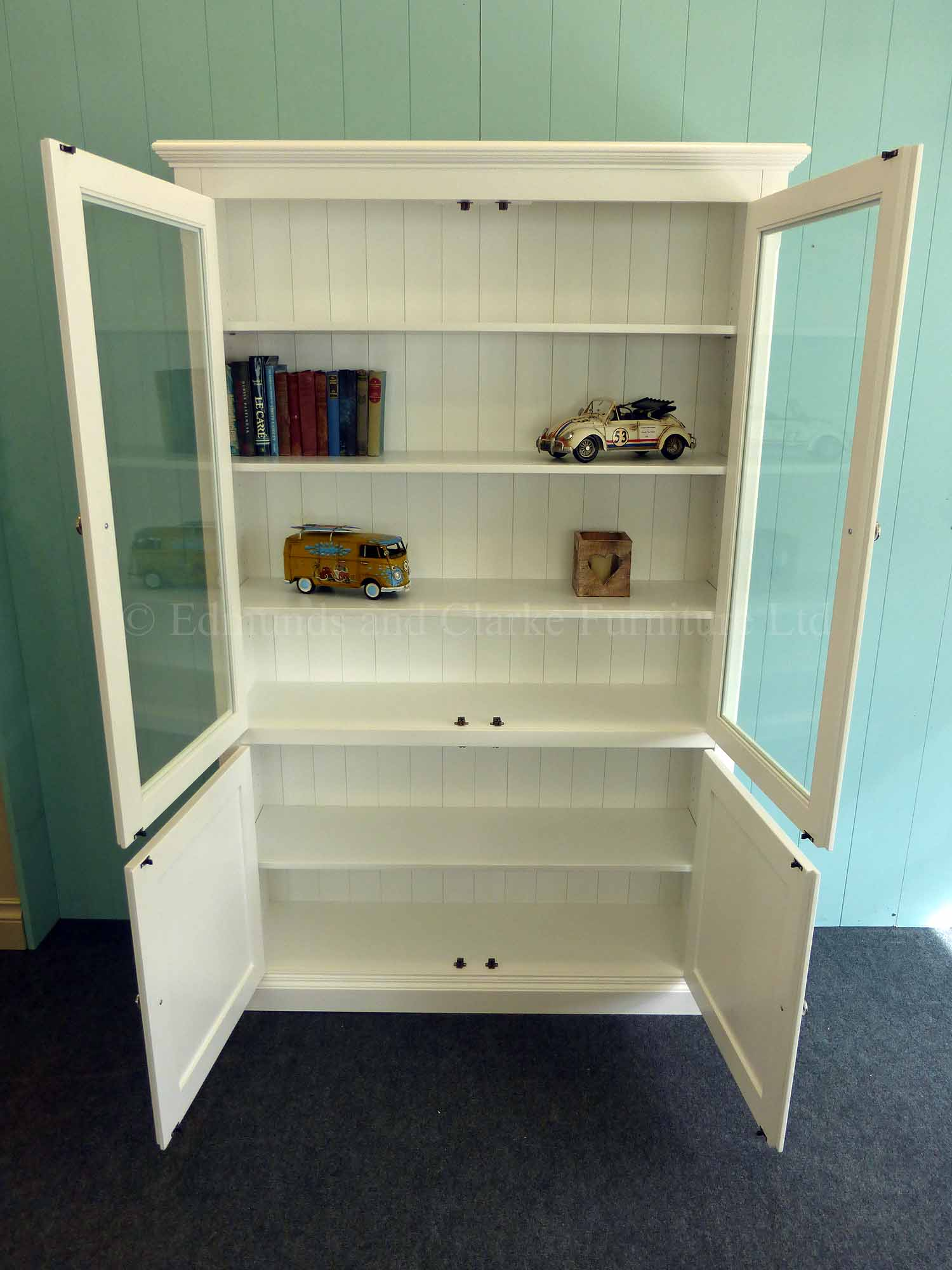 Edmunds painted white glazed and paneled bookcase, adjustable shelves