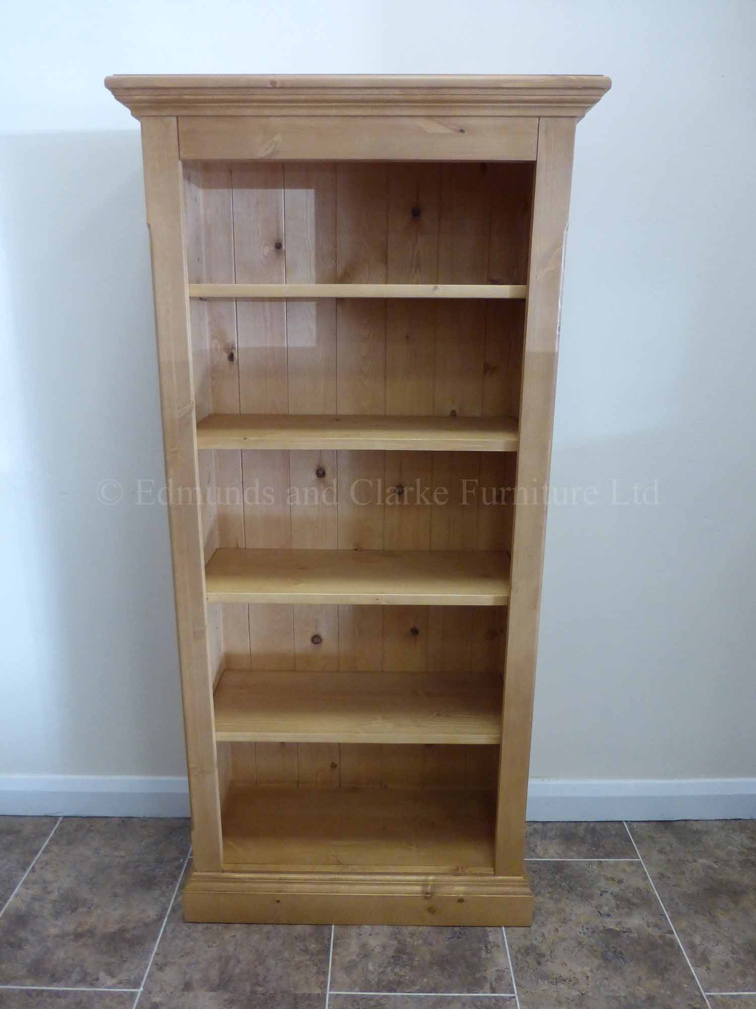 Edmunds Pine Shallow Depth Bookcases. Image shows tall narrow style bookcase with 4 adjustable shelves waxed pine finish all over. many finishes and sizes available
