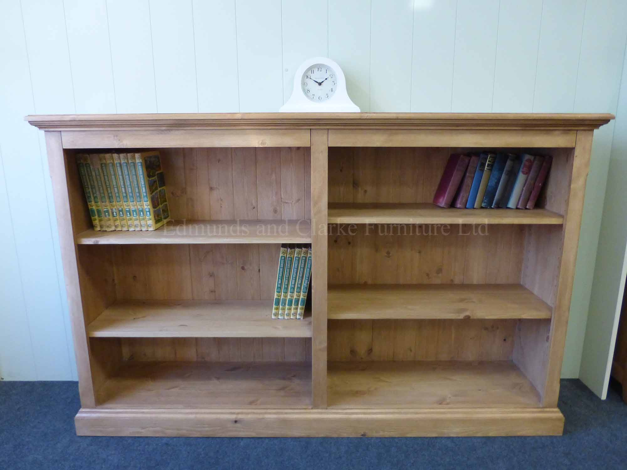 Edmunds long low waxed pine bookcase with adjustable shelves