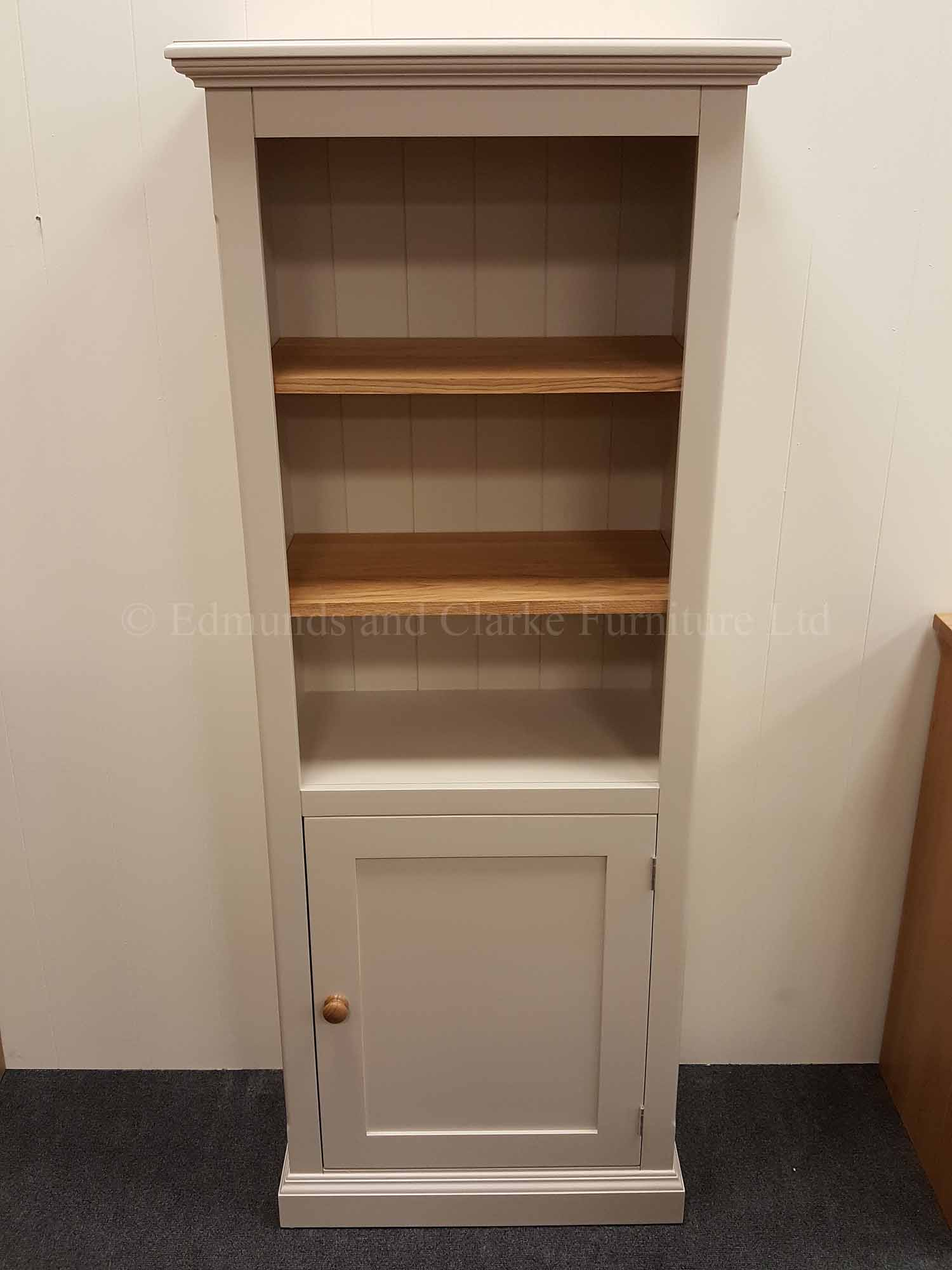 Painted narrow one door bookcase two adjustable shelves with door below
