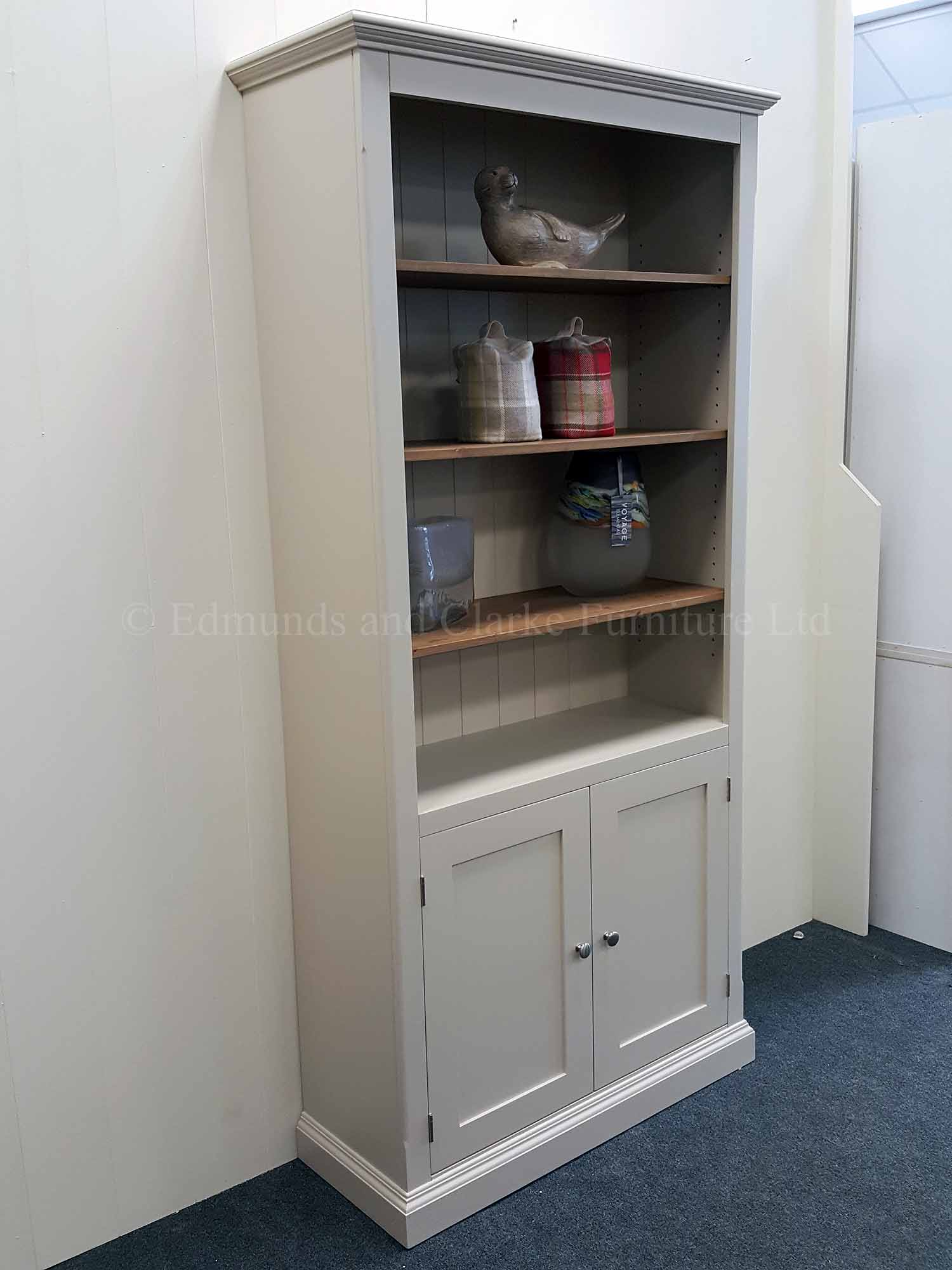 Edmunds painted bookcase with two door cupboard below adjustable shelves above