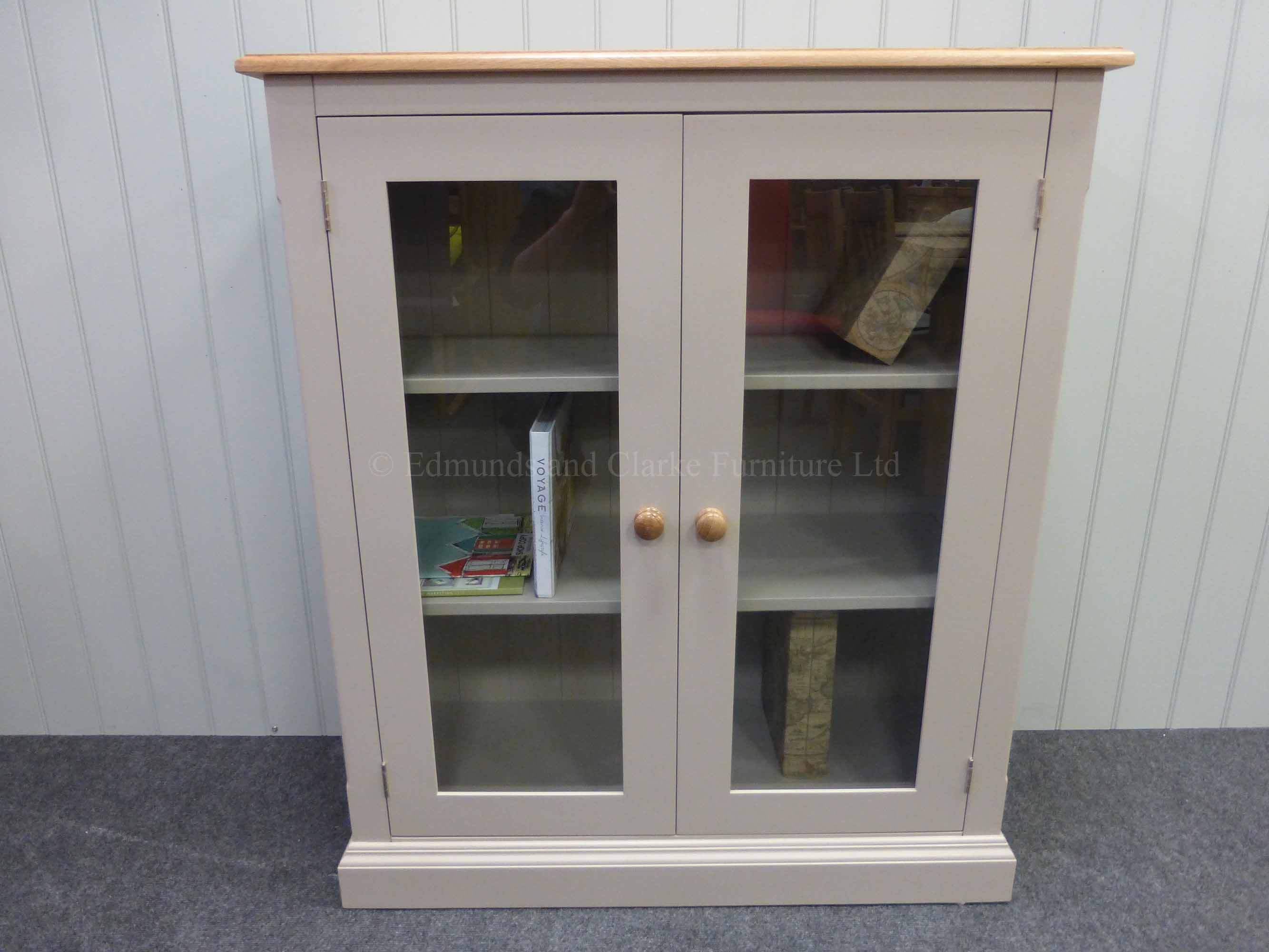 Edmunds Painted Fully Glazed Bookcases. Image showing painted all over with oak top and oak handles, many colour and handle options available. mouled plinth and cornice