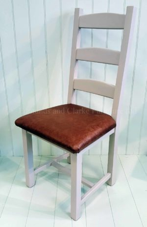 Edmunds Amish dining chair, image showing dunwich stone with genuine leather seat pad dark brown. Chair frame available painted, waxy lacquer feel or solid oak, choose your options