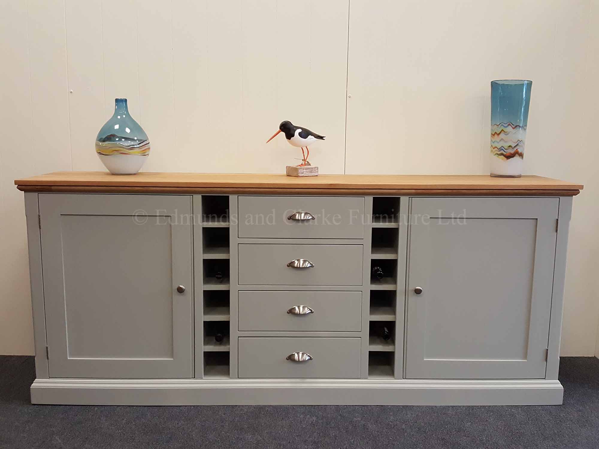 Edmunds Painted 7ft Multi Sideboard. can hold upto 12 bottles of wine. centre drawers with wine rack either side then door either side. hampton moulded top