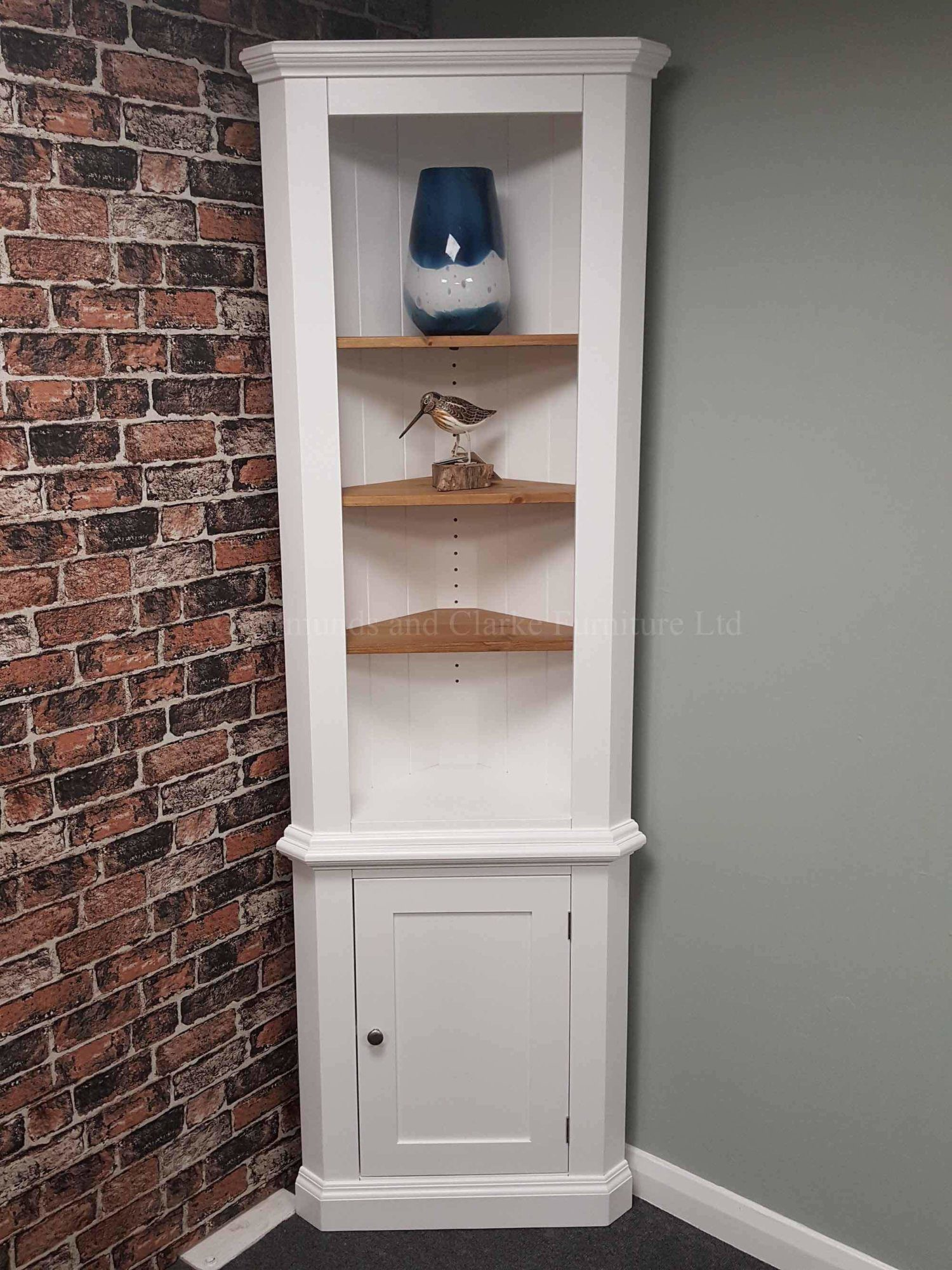 edmunds painted corner cupboard. image showing painted all over with open pine shelves and cupboard underneath. 10 colours to choose from with various handle options only at edmunds clarke bury st edmunds